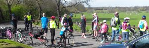 Happy cyclists gather in Norman Park